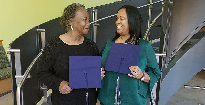 Latonia Darien-Grundy walked her mom, Marie Grimes, to her first class on Tidewater Community College's Chesapeake Campus in 2014.
