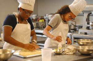 Students learn to make paninis at the Norfolk Campus.