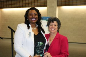 Shorntail Goodrich accepts her leadership award from Linda Berardi, chair of the Women's Center Advisory Council.