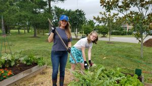 Carroll-Hendricks and daughter Lexi work together at the garden.