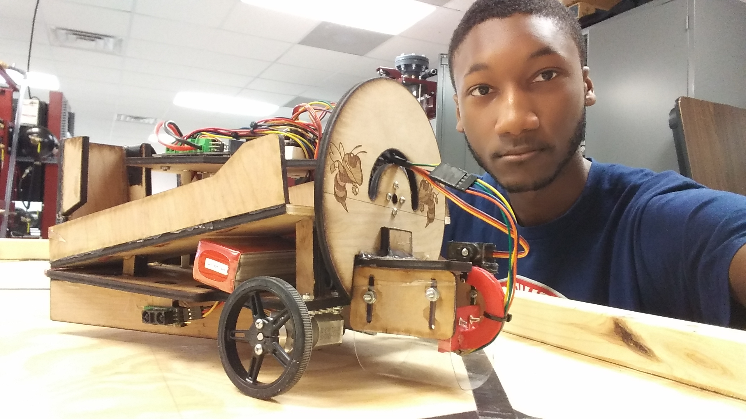 Ramon Veal poses with the STEM Club robot.