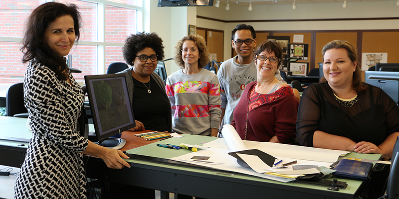 TCC Instructor Lana Sapozhnikov and her class pose for a photo in one of TCC's interior design labs.