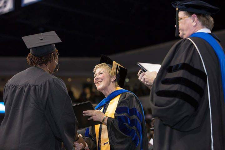 President Edna Baehre-Kolovani congratulates a graduate