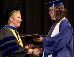 President Edna V. Baehre-Kolovani congratulates a graduate at TCC's 59th Commencement Exercises