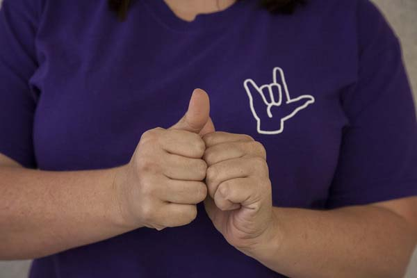 American Sign Language includes hand shapes, movements and facial expressions.
