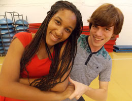Two ballroom dancing students at TCC smile and have fun.