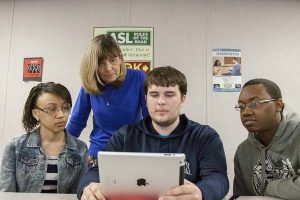 Business professor Linda Williams engages students with classroom exercises and interactive exchanges