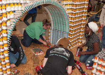Engineering Club students work on a bridge design made out of cans