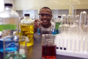 Student working in chemistry lab.
