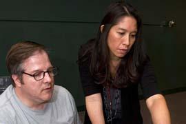 Professor Cindy Bird helps a student