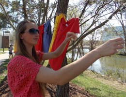 A student hangs a tshirt