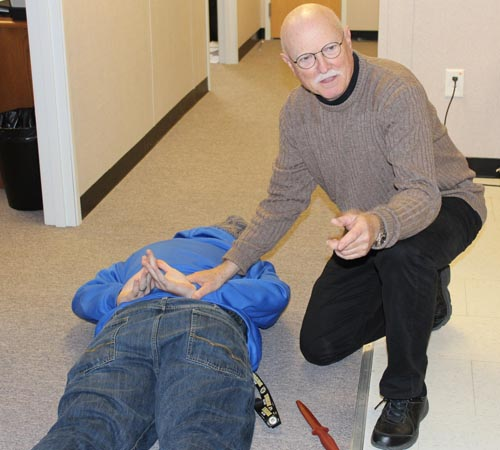 Bill Pearsall, program head at the Chesapeake Campus, works with students during a scenario.