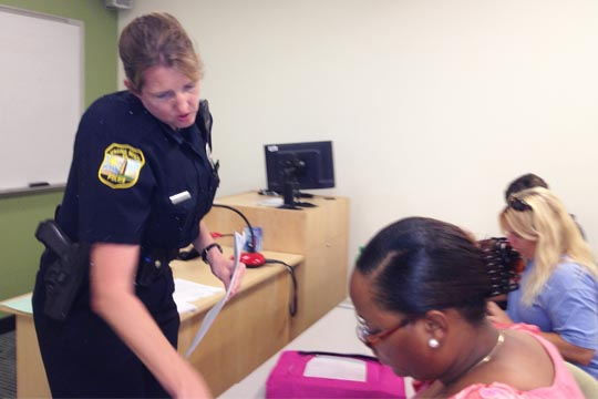 Virginia Beach Police Officer Helen Gillespie helps a student during class