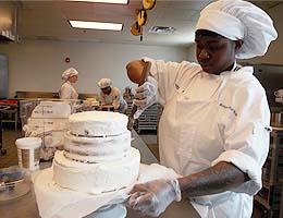 Monique Arthur-Noel ices a cake.