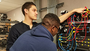 Two students working on a mechatronics board