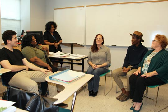 Human Services students Samuel Melchione, Shinisa Thomas, Christina Byrd, Justin Fleming, and Pamela Nobles role play a counseling session focusing on interracial marriage.