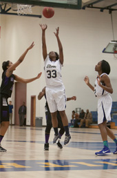 Lakendra Smith jumps for the rebound