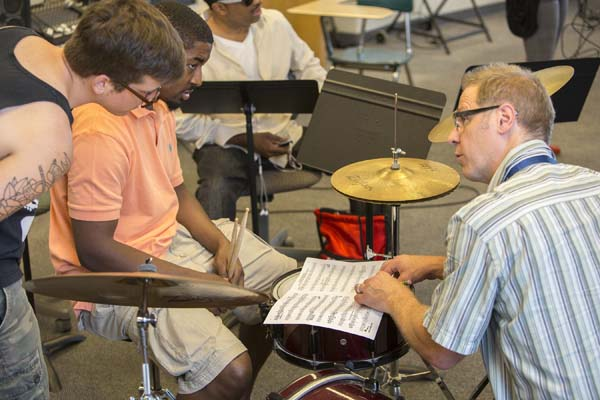 Professor Denison works on techniques with percussionists.