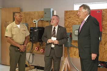 A TCC student talks with Gov. McAuliffe and Dean Thomas Stout about the solar program