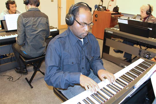 Students practice in the new piano lab on the Norfolk Campus.