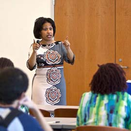Woman speaks to participants of employment workshop