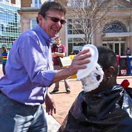 Man puts a pie on the face of math professor Coby Dillard