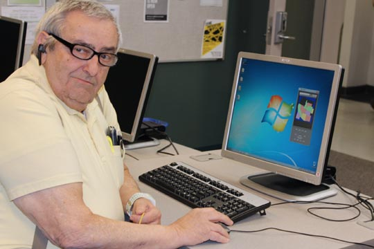 Student David Scholefield creating a mobile application that his grandchildren can use