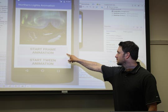 Professor Jared Oliverio demonstrating frame animations on a mobile application