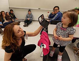 Psychology instructor Andrea Palmisano shows Joele her reflection