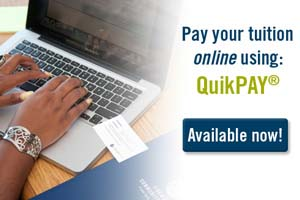 student paying tuition online