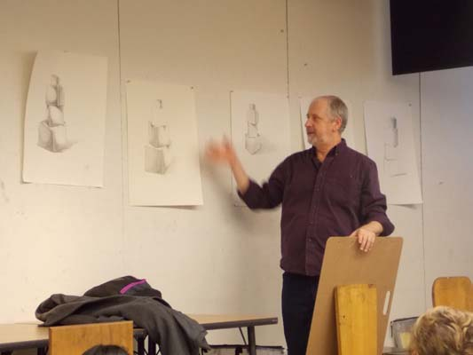 Robert Hawkes in front of a Drawing I class