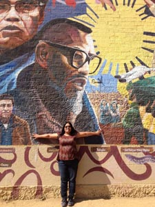 Sandra Itliong-Bowman in front of her father's mural in Filipinotown, Los Angeles