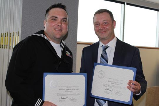 Graduates Jeff Steinmetz, left, and Jacob Hodges
