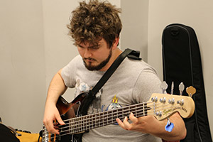 student playing the bass guitar