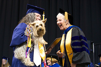 Lesley Richardson and her service dog, Baylee.
