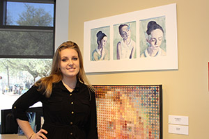Kirsten Whitehouse posing with her painting