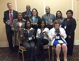 TCC business students pose with their awards
