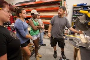 Matt Gorris instructs students on the proper use of tools when building sets