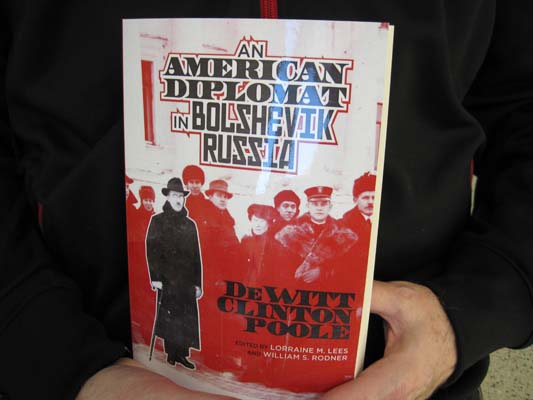 Hands holding the book An American Diplomat in Bolshevik Russia