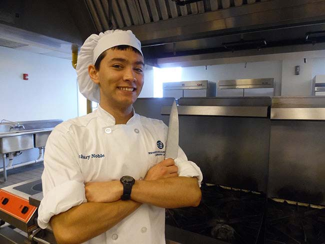 TCC Culinary Arts student Zachary Noble getting hands-on kitchen experience