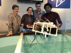 Professor Duffy with students at Nauticus