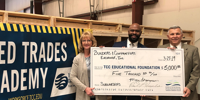 The Educational Foundation receiving a check