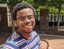 Mekhi Moore at rest on a bench on TCC's Norfolk Campus.