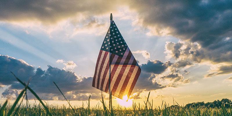 United States of America flag at sunset.